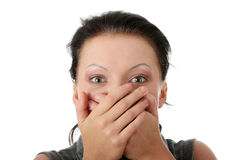 Covering her mouth with hands Royalty Free Stock Images