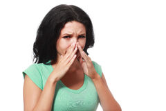 Covering her nose. After a bad smell royalty free stock images
