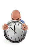 Covering his face with clock Royalty Free Stock Photos