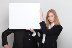Covering man's face with poster Royalty Free Stock Image