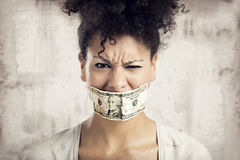 Covering mouth with a dollar banknote Royalty Free Stock Images