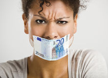 Covering mouth with a euro banknote Stock Images