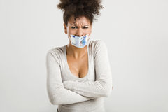 Covering mouth with a euro banknote Royalty Free Stock Photos