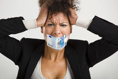 Covering mouth with a euro banknote Royalty Free Stock Photo