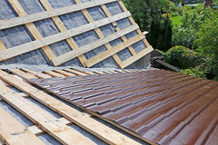 Covering the roof of a metal tile Stock Image