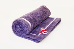 Coverlet, blanket. Purple blanket with a pacifier on a white background Stock Photography