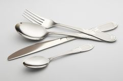 Covers. Cover the small spoon the greater spoon a plug and a knife Stock Photo