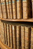 Covers of old medieval books on shelf in bookcase Royalty Free Stock Photos