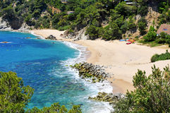 Coves of Cala Llorell beach in Tossa de Mar, Spain Stock Images