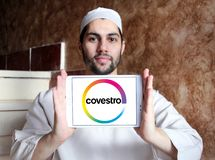 Covestro company logo. Logo of Covestro company on samsung tablet holded by arab muslim man. The main industries served are automotive manufacturing and supply Royalty Free Stock Photo