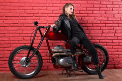 Coveted Woman Or Girl In A Leather Jacket And Tight Pants, Boots Royalty Free Stock Photos