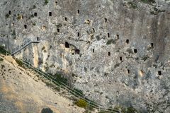 Covetes dels Moros with tourists in holes Royalty Free Stock Images