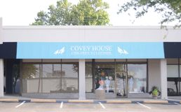 Covey House Children`s Clothier, Fort Worth, Texas. Covey House sell kid`s clothes and accessories in a wide range of styles. Brands include Columbia, Criquet stock photos