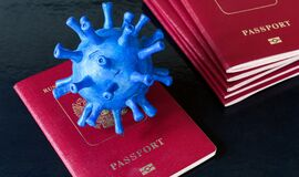 Free COVID-19 Coronavirus Pandemic And Travel Concept, Model Of Novel Corona Virus On Tourist Passport, Restrictions For Tourism Due To Stock Images - 183156184