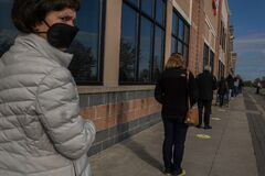 Free Covid-19, Long Line Of Face-masked People Waiting To Enter A Food Market In Suburban Philadelphia, PA, April 11, 2020 Royalty Free Stock Photography - 178930497