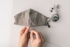 Free COVID-19 Making DIY Face Masks At Home Sewing Fabric Mask To Help Healthcare Medical Workers With PPE Shortage With Royalty Free Stock Images - 179922849