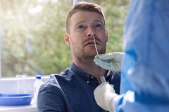 Free Covid-19 Nasal Swab Test - Doctor Taking A Mucus Sample From Patient Nose Royalty Free Stock Image - 196870506