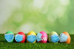 Free COVID-19 Pandemic. Colorful Easter Eggs In Protective Masks On Green Grass Royalty Free Stock Photography - 207932257