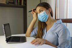 Free COVID-19 Pandemic Coronavirus Doubt Student Girl Home Schooling E-learning Mask Study From Home Laptop. Distance Learning Stock Photography - 178985892