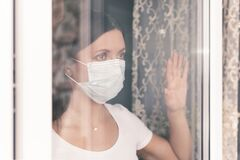 Free COVID-19 Pandemic Coronavirus Woman Home Isolation Quarantine Wearing Mask Protective Against SARS-CoV-2. Quarantine Girl With Royalty Free Stock Images - 178395749