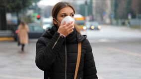 Free COVID-19 Pandemic Coronavirus Woman In City Street Wearing Face Mask Protective For Spreading Of Disease Virus SARS-CoV-2. Girl Wi Stock Photos - 170731493
