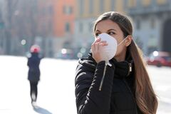 Free COVID-19 Pandemic Coronavirus Woman In City Street Wearing Face Mask Protective For Spreading Of Disease Virus SARS-CoV-2. Girl Wi Royalty Free Stock Photo - 173849025