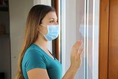 Free COVID-19 Pandemic Coronavirus Woman Quarantine Home Isolation Wearing Face Mask Against Disease Virus SARS-CoV-2. Girl Looking Royalty Free Stock Photos - 178567508