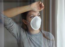 Free COVID-19 Pandemic Coronavirus Woman Quarantine Home Isolation Wearing Mask Protective Waiting End Of Pandemic SARS-CoV-2. Girl Stock Images - 176427084