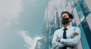 Free Covid-19 Situation In Business Concept. Businessman With Safety Mask Standing In The City. Protected And Care Of Health. Stressed Stock Image - 182423491