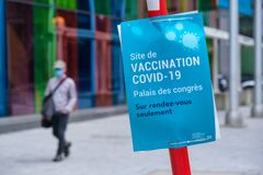 Free Covid-19 Vaccination Centre Sign In Front Of Olympic Stadium In Montreal Royalty Free Stock Photography - 217318187