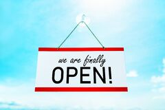 Free COVID-19 WE`RE FINALLY OPEN ! Sign Hanging On Window Store End Of Confinement Stores Reopening . Retail Businesses Royalty Free Stock Photography - 184273767