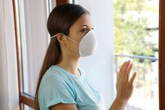 Free COVID-19 Woman Home Isolation Auto Quarantine Wearing Face Mask Protective For Spreading Of Disease Virus SARS-CoV-2. Girl Royalty Free Stock Images - 175020249