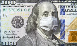 COVID-19 coronavirus in USA, 100 dollar money bill with face mask. Coronavirus affects global stock market