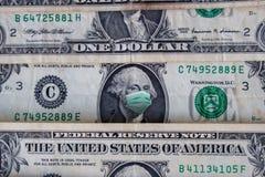 COVID-19 coronavirus in USA, 1 dollar money bill with face mask. Coronavirus affects global stock market. World economy hit by