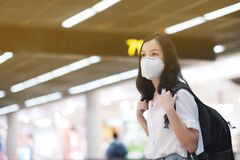 COVID-19 Crisis, Asian travelers girl and surgical mask in airports