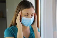COVID-19 Pandemic Coronavirus Close up Sick Woman Headache Home Quarantine Wearing Surgical Mask Against SARS-CoV-2. Girl with