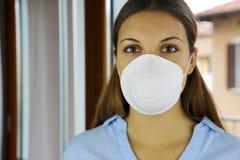 COVID-19 Pandemic Coronavirus Mask Woman nurse hospital or home isolation auto quarantine for virus SARS-CoV-2. Girl voluntary