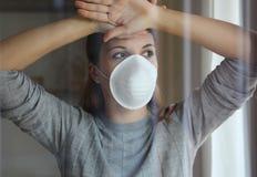 COVID-19 Pandemic Coronavirus Woman Home Isolation Quarantine Wearing Mask Protective Against SARS-CoV-2. Quarantine girl with