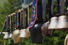 Cow bells in row Stock Photos