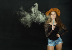 Cow boy blowing on gun Royalty Free Stock Photography