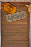 Cow boy hut on wall background Royalty Free Stock Images
