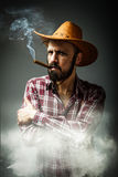 Cow boy portrait with smoke around Stock Photos