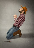 Cow boy pray for forgiveness Royalty Free Stock Photos