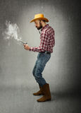 Cow boy pray shot with gun Royalty Free Stock Photos