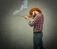 Cow boy shot with rifle in profile view Royalty Free Stock Photography