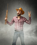 Cow boy in a winning situation with rifle Royalty Free Stock Image