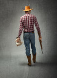 Cow boy wins teddy at aiming leisure game Royalty Free Stock Images