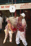 Cow carcass on scale being weighed at Nyongara slaughterhouse in Nairobi, Kenya, Africa Stock Images