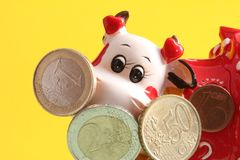 Cow and coins Royalty Free Stock Images