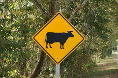 Cow crossing road sign Stock Photography